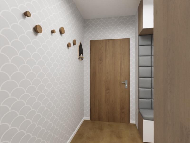 szary przedpokój - wieszaki na ścianie